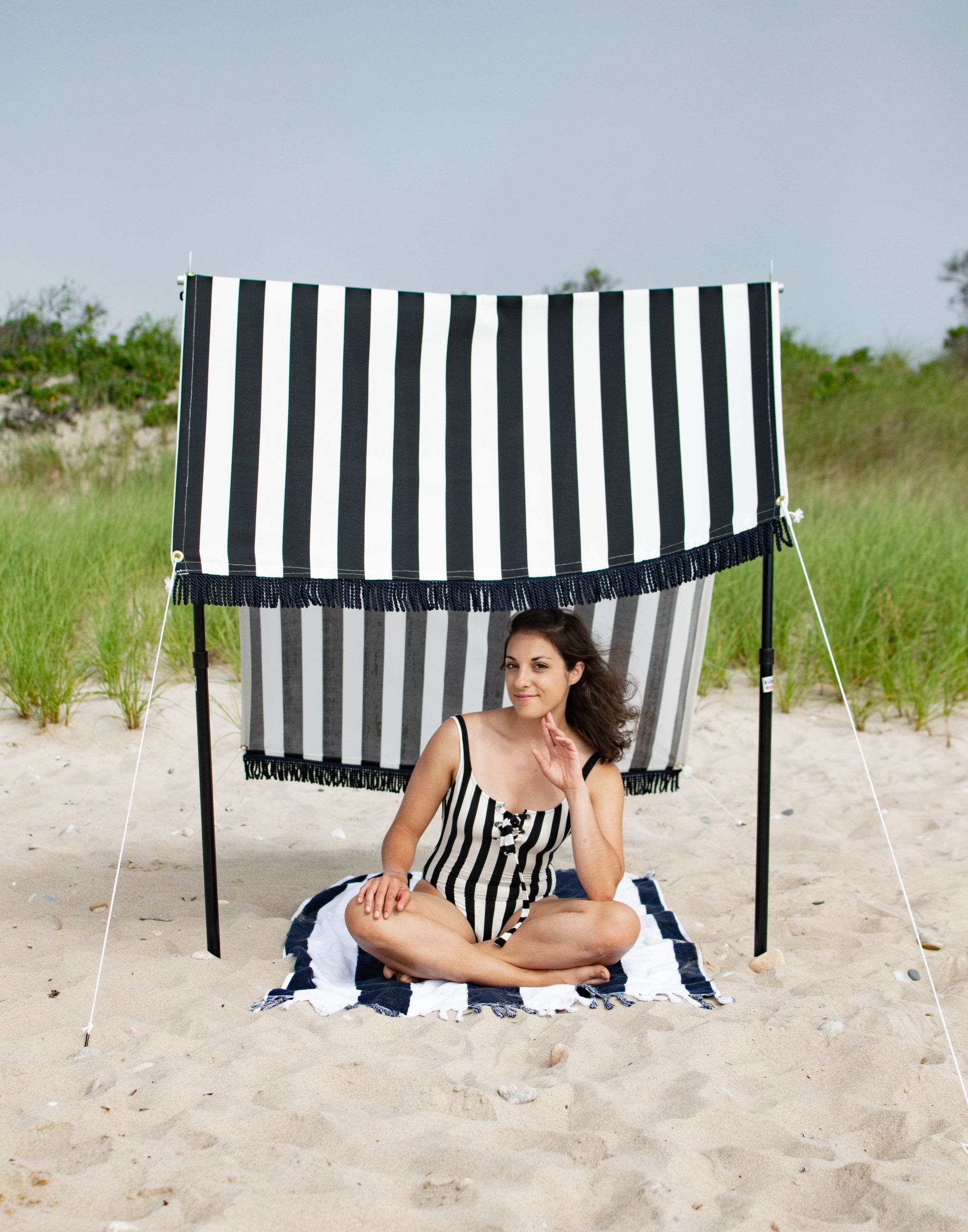 A DIY beach tent that is adjustable to the sun!